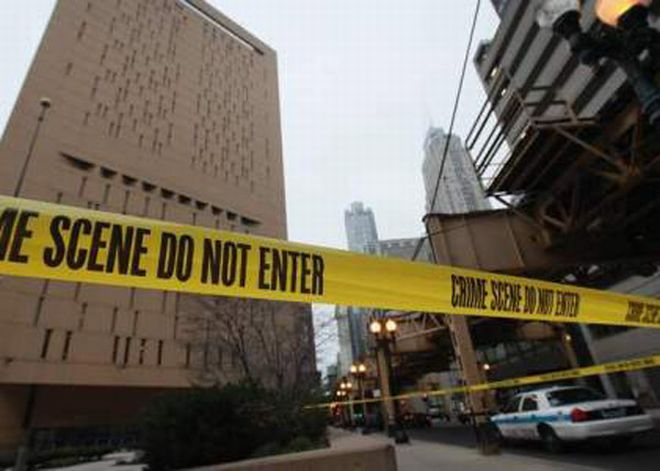 CHICAGO, IL - DECEMBER 18:  Crime scene tape surrounds the feder
