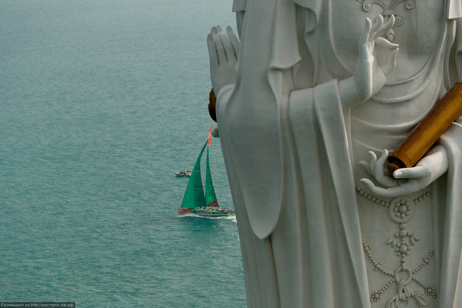 Groupama Sailing Team, skippered by Franck Cammas from France, sails past the Guan Yin of the South Sea of Sanya, at the start of leg 4 of the Volvo Ocean Race 2011-12, from Sanya, China to Auckland, New Zealand. (Credit: PAUL TODD/Volvo Ocean Race)